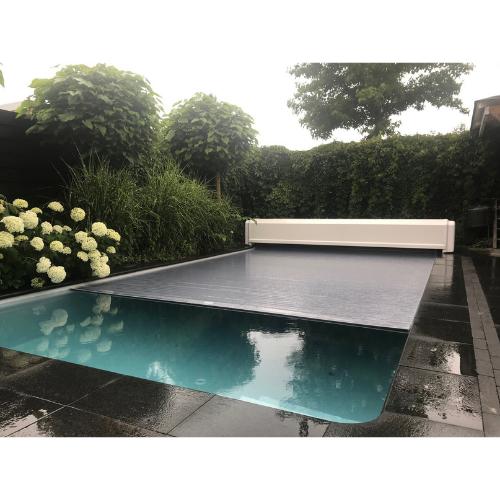 bouwkundig zwembad 7 x 3,5 met lamellenafdekking