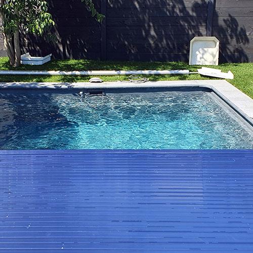aanleg polyester zwembad Kariba 700 met lamellenafdekking